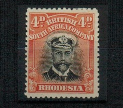 RHODESIA - 1913 4d black and orange-red