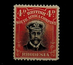 RHODESIA - 1913 4d black and orange red