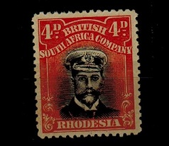 RHODESIA - 1913 4d black and orange