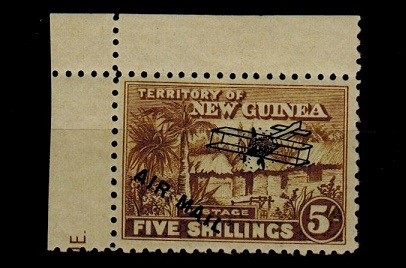 NEW GUINEA - 1931 5/- olive bistre  mint showing the variety SHORT I IN MAIL variety.  SG 147.