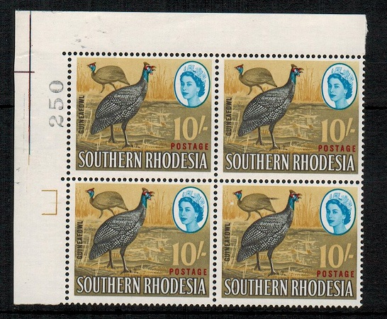 SOUTHERN RHODESIA - 1964 10/- U/M block of four with EXTRA FEATHER variety.  SG 104a.