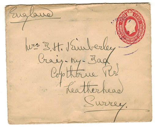 TANGANYIKA - 1927 15c red PSE addressed to UK used at MBOZI and struck in violet ink.  H&G 2.