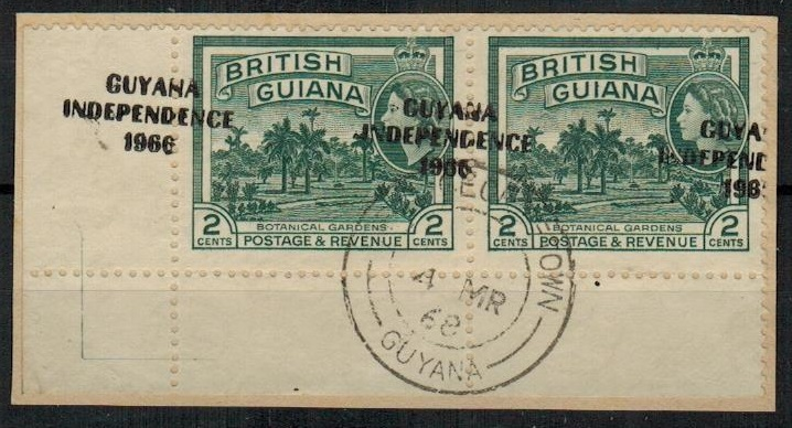 BRITISH GUIANA - 1968 2c myrtle green overprint pair on piece with GROSSLY MISPLACED OVERPRINT.