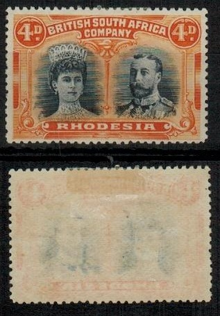 RHODESIA - 1910-13 4d greenish black and orange fine mint with GASH IN EAR variety.  SG 138.