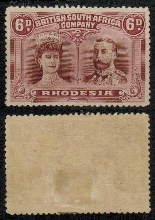 RHODESIA - 1910-13 6d red-brown and mauve fine mint with GASH IN EAR variety.  SG 144.