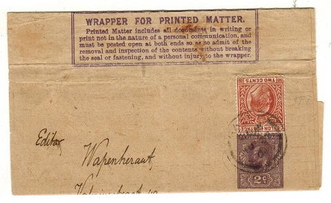 CEYLON - 1909 2c dark violet postal stationery wrapper (creased) uprated to Holland.  H&G 8.