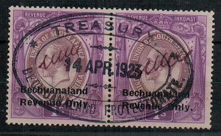 BECHUANALAND - 1923 1/- violet REVENUE pair used at the Treasury.